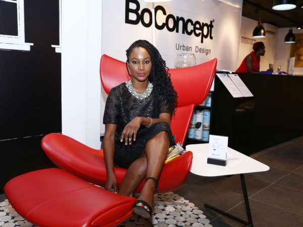 Isio Wanogho in Exclusive Red Lather Design Chair