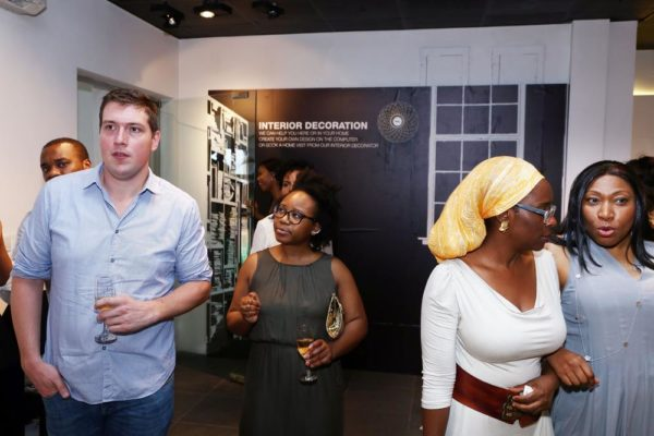 Jonathan Millard & Other Guests Entering the Exhibition