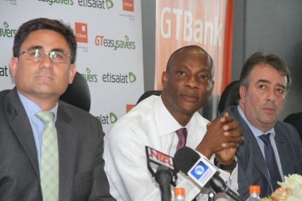 Chief Executive Officer, Etisalat Nigeria, Matthew Willsher; Managing Director and CEO of Guaranty Trust Bank Plc, Segun Agbaje; and Chief Marketing Officer, Etisalat Nigeria, Angelone Francesco