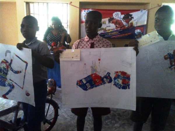 Peter Daniel (3rd Position), Science Primary School, Abuja; Mohammed Musa (2nd Position), Eucaristic Heart Of Jesus Model School and pupil of Lea Apo Village School, Friday Gowon, 1st  Position and winner of 50 thousand naira in the Imagine and Achieve Art Competition in Abuja