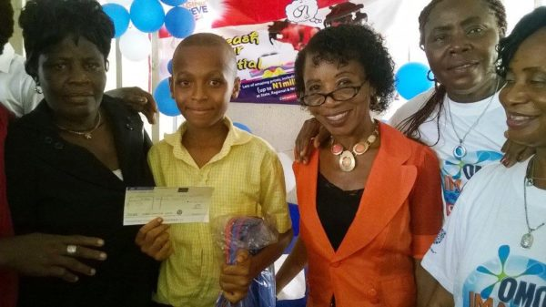 Echewuodo Anthony (middle), Ihiagwa Pry School, third position and winner of 15 thousand naira in the Imagine and Achieve Essay Competition in Imo State