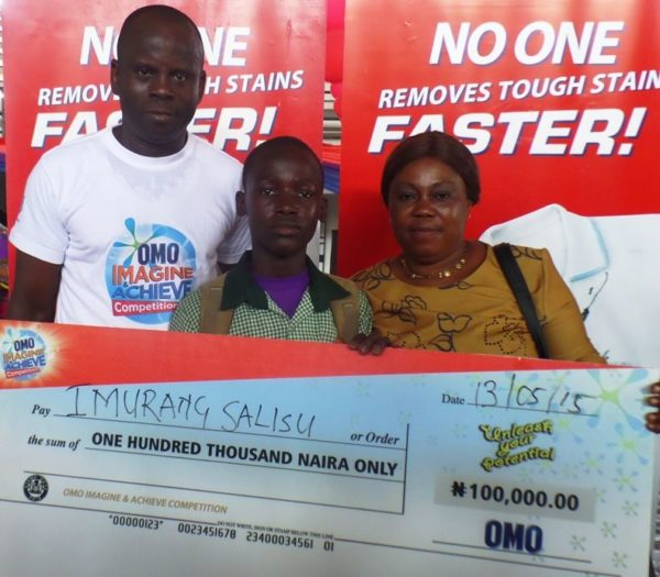 Coordinator, Children of Africa, Kunle Alaba; Omo Imagine and Achieve Art Competition 1st place winner,  Imurang Salisu and Mrs Salisu (winners mother) at the Lagos State finals of the Omo 'Imagine and Achieve'  Competition