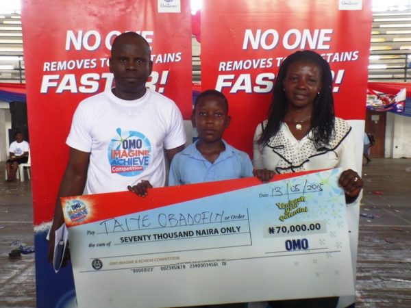 Coordinator, Children of Africa, Kunle Alaba; Omo Imagine and Achieve Art Competition first runner-up, Taiye Obadofin and Mrs Obadofin at the Lagos State finals of the Omo Imagine and Achieve competition.