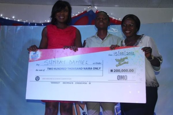 Omo Brand Ambassador Chioma Akpotha; third position and winner of 200 thousand naira, from De Brain Foundation School, Kaduna, Sunday Daniel and Mrs. Daniel (Mother) at the Omo Imagine and Achieve Competition grand finale in Lagos