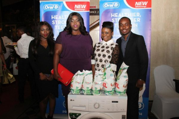 Media Manager, P&G Nigeria, Adigolo Funmilola; P&G's Commercial & Brand Operations Director, Enekabor Ehinomen; Winner of Oral B Smile of the Day competition with her washing machine, Adebanke Elegbede; and Folarin Ojo, Brand Manager for Oral B.