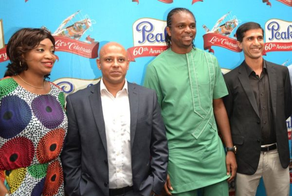 Dolapo Otegbayi, Marketing Manager, FrieslandCampina WAMCO Nigeria Plc; Tarang Gupta, Marketing Director, FrieslandCampina WAMCO Nigeria Plc; Nwankwo Kanu, Nigeria's Ex-International and Rahul Colaco, Managing Director, FrieslandCampina WAMCO Nigeria Plc at the Peak 60th Anniversary Celebration Event held at Eko Hotel on Saturday, May 23, 2015