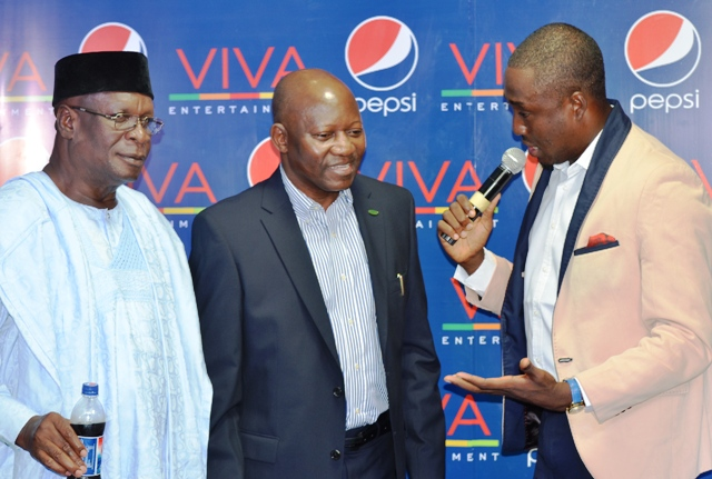 Actor, Olumide Bakare and General Manager, Bank of Industry, Joseph Babatunde with the MC