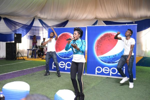 Debbie Rise of Nigerian Idol Performing at the unveiling event