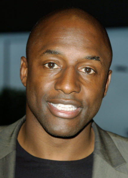 """LONDON - JULY 5: John Fashanu attends the """"London Club and Bar Awards 2005"""" at Riverbank Park Plaza hotel on July 5, 2005 in London, England. (Photo by David Westing/Getty Images)"""