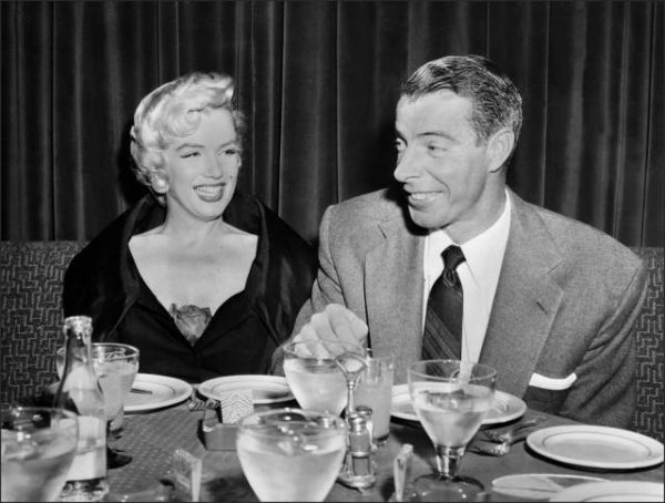 SAN FRANCISCO, UNITED STATES:  Picture dated of the fifties showing American actress Marilyn Monroe (L) with her husband baseball legend Joe DiMaggio. (Photo credit should read AFP/AFP/Getty Images)