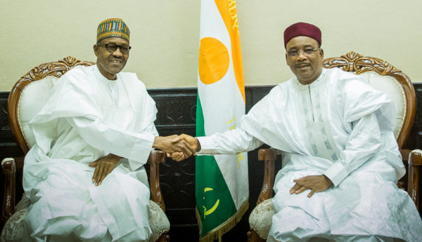 PIC. 2. PRESIDENT MUHAMMADU BUHARI (L), IN A HANDSHAKE WITH PRESIDENT MAHAMADOU ISSOUFUO OF NIGER REPUBLIC, DURING A BILATERAL   MEETING ON BOKO HARAM IN NIAMEY ON WEDNESDAY (3/6/15). 2892/3/6/2015/ICE/BJO//NAN