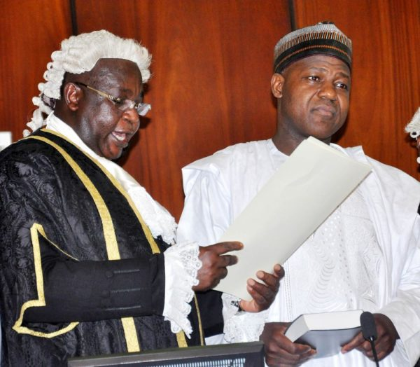 PIC.12.CLERK OF THE NATIONAL ASSEMBLY, SALISU MAIKASUWA (L) SWEARINNG-IN  THE SPEAKER OF THE HOUSE OF REPRESENTATIVES, REP. YAKUBU DOGARA AT THE  INAUGURATION OF THE 8TH NATIONAL ASSEMBLY IN ABUJA ON TUESDAY (9/6/15). 3012/9/6/2015/CH/BJO/NAN