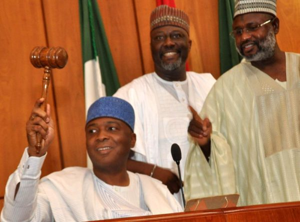 PIC.14.THE SENATE PRESIDENT, BUKOLA SARAKI USING THE GAVEL AT THE INAUGURATION OF THE 8TH NATIONAL ASSEMBLY IN ABUJA  ON TUESDAY (9/6/15).WITH HIM ARE SENATORS DINO MELAIYE (M) AND SANI YERIMA 3014/9/6/2015/CH/BJO/NAN