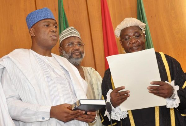 PIC.15.CLERK OF THE NATIONAL ASSEMBLY, SALISU MAIKASUWA (R) SWEARINNG-IN  THE SENATE PRESIDENT, BUKOLA SARAKI AT THE INAUGURATION OF THE 8TH  NATIONAL ASSEMBLY IN ABUJA ON TUESDAY (9/6/15). 3015/9/6/2015/CH/BJO/NAN