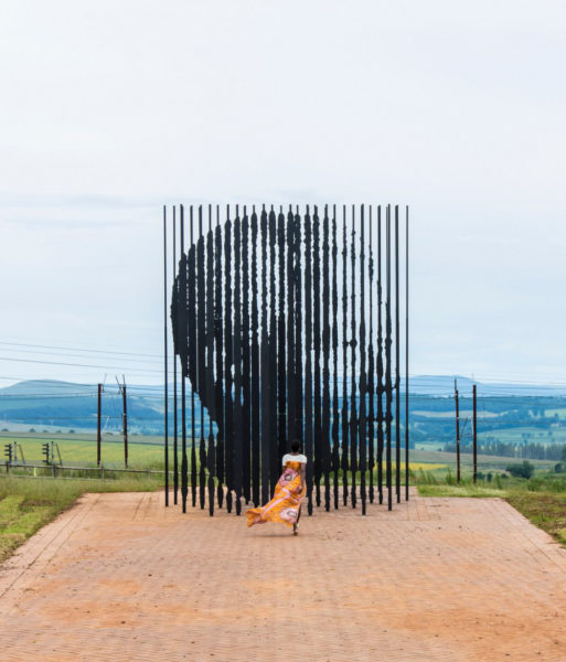 Vimbai at Nelson Mandela capture site in her Toju Foyeh high low dress