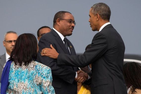 President Barack Obama, right, shakes hands with Ethiopian Prime Minister Hailemariam Desalegna after arriving at Addis Ababa Bole International Airport, on Sunday, July 26, 2015, in Addis Ababa. Obama is the first sitting U.S. president to visit Ethiopia. (AP Photo/Evan Vucci)