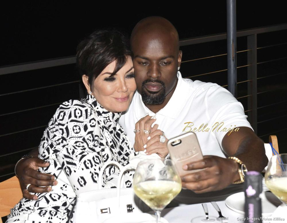 love is in the air kris jenner and boyfriend corey gamble share a kiss at haute living event