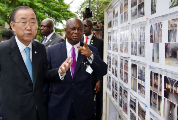 PIC. 2. THE SECRETARY-GENERAL OF UNITED NATIONS (UN), MR BAN KIMOON (L) AND PERMANENT SECRETARY, FCT, MR JOHN CHUKWU, INSPECTING A PHOTO MONTAGE, BEING RECORD OF UNITED NATIONS BUILDING BOMBED THROUGH A CAR EXPLOSION IN AUGUST 2011, AT THE SITE IN ABUJA ON TUESDAY (24/8/15). 6134/24/8/2015/BJO/NAN