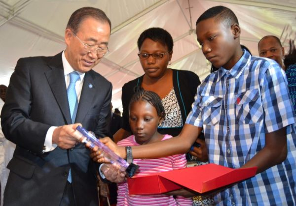 PIC. 3. THE SECRETARY-GENERAL OF UNITED NATIONS, MR BAN KIMOON (L), RECEIVING A PRESENT FROM WIDOW OF A VICTIM OF THE AUGUST 2011 UNITED NATIONS BUILDING BOMBING, MRS KEHINDE ADEWOLE AND HER CHILDREN, DAVID AND SARAH, DURING THE VISIT OF THE SECRETARY-GENERAL TO THE BOMBED UN HOUSE IN ABUJA ON TUESDAY (24/8/15). 6135/24/8/2015/BJO/NAN