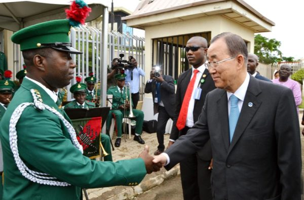 PIC. 5. THE SECRETARY-GENERAL OF UNITED NATIONS, MR BAN KIMOON (R), GREETS THE OFFICER-IN-CHARGE OF THE GUARDS BRIGADE BAND, CAPT. STEPHEN ENWEMUCHE, AFTER ADDRESSING STAFF OF UNITED NATIONS AGENCIES, DURING HIS VISIT TO THE BOMBED UNITED NATIONS BUILDING, IN ABUJA ON TUESDAY (24/8/15). 6137/24/8/2015/BJO/NAN