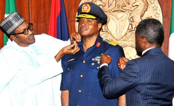 PIC 4.  PRESIDENT MUHAMMADU BUHARI (L)  AIDED BY VICE-PRESIDENT YEMI  OSINBAJO  IN DECORATING THE CHIEF OF AIR  STAFF,  AIR VICE-MARSHAL  SADIQUE ABUBARKAR  WITH HIS NEW RANK OF  AIR-MARSHAL  AT THE PRESIDENTIAL  VILLA IN ABUJA ON THURSDAY (13/8/15). 5929/13/8/2015/ICE/CH/NAN