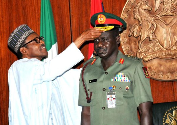 PIC.6. PRESIDENT MUHAMMADU BUHARI DECORATING  THE CHIEF OF ARMY STAFF,  MAJ.-GEN. TUKUR  BURATAI WITH HIS NEW RANK CAP OF  LT.-GEN,  AT THE   PRESIDENTIAL VILLA IN ABUJA ON THURSDAY (13/8/15). 5931/13/8/2015/ICE/CH/NAN