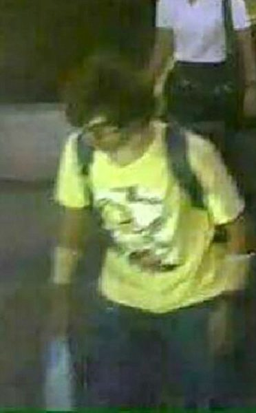 ©Nicholas Razzell 18.08.15 M) 07976 449 585ref: nxr Pic shows: Security camera CCTV released today by the Thai Authorities showing a male suspect wearing a yellow shirt near the Erawan Shrine in Bangkok who was seen with a plastic bag and backpack, only to appear later without Tthe backpack. - see story. Pic by: Nick Razzell