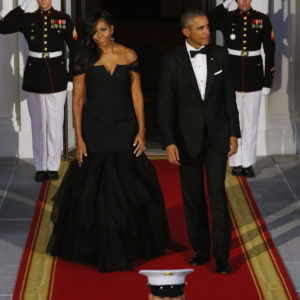WASHINGTON, DC - SEPTEMBER 25:  U.S. First Lady Michelle Obama and U.S. President Barack Obama wait on the North Portico for the arrival of Chinese President Xi Jinping and his wife Madame Peng Liyuan ahead of a state dinner at the White House September 25, 2015 in Washington, DC. Obama and Xi announced an agreement on curbing climate change and an understanding on cyber security.  (Photo by Chip Somodevilla/Getty Images)