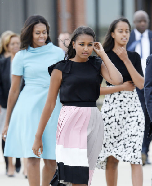 JOINT BASE ANDREWS, MD - SEPTEMBER 22:   First Lady Michelle Obama with daughters Sasha and Malia arrive to welcome His Holiness Pope Francis on his arrival from Cuba September 22, 2015 at Joint Base Andrews, Maryland. Francis will be visiting Washington, New York City and Philadelphia during his first trip to the United States as pope.  (Photo by Olivier Douliery-Pool/Getty Images)