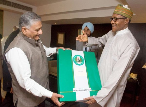 PIC. 32. PRESIDENT MUHAMMADU BUHARI (R), PRESENTING A GIFT TO GEN.VIJAY KUMAR SINGH, DURING PRESIDENT BUHARI'S MEETING WITH GEN. SINGH AND SOME OF HIS SENIOR ALUMNI, DURING THE 3RD INDIA-AFRICA FORUM SUMMIT, IN NEW DELHI, INDIA ON WEDNESDAY (28/10/15). 3898/28/10/2015/ICE/BJO/NAN