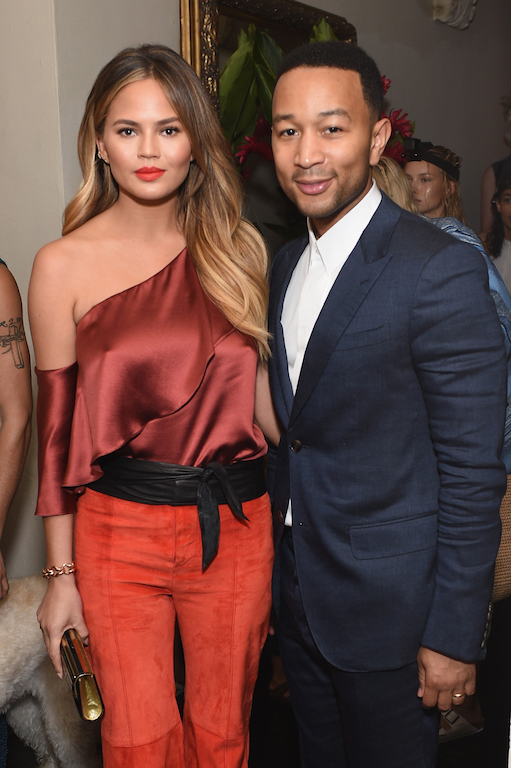 LOS ANGELES, CA - OCTOBER 20: Model Chrissy Teigen (L) and recording artist John Legend attend CFDA/Vogue Fashion Fund Show and Tea at Chateau Marmont on October 20, 2015 in Los Angeles, California. (Photo by Stefanie Keenan/Getty Images for CFDA/Vogue)