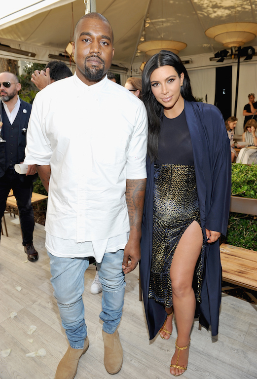 LOS ANGELES, CA - OCTOBER 20: Recording artist Kanye West (L) and TV personality Kim Kardashian attend CFDA/Vogue Fashion Fund Show and Tea at Chateau Marmont on October 20, 2015 in Los Angeles, California. (Photo by Donato Sardella/Getty Images for CFDA/Vogue)
