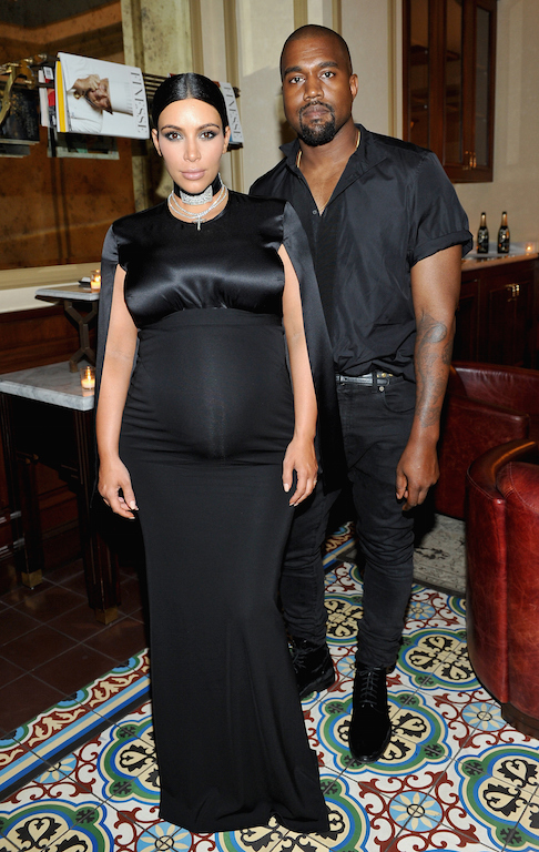 BEVERLY HILLS, CA - OCTOBER 20: Tv personality Kim Kardashian (L) and recording artist Kanye West attend the CFDA/Vogue Fashion Fund Dinner at Bouchon Beverly Hills on October 20, 2015 in Beverly Hills, California. (Photo by Donato Sardella/Getty Images for CFDA/Vogue)