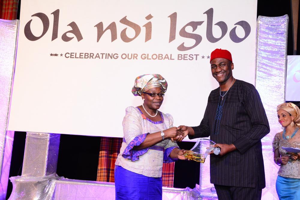 Oby Ezekwesili presenting an Award to Nnaeto Orazulike