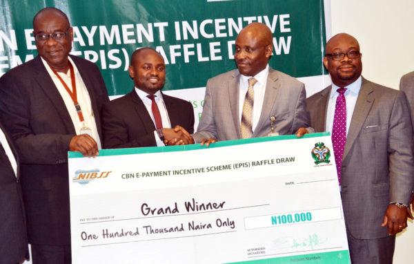 PIC. 16. PRESENTATION OF CBN EPIS RAFFLE CASH REWARD IN ABUJA