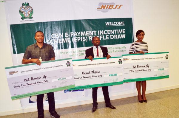 PIC. 17. PRESENTATION OF CBN EPIS RAFFLE CASH REWARD IN ABUJA