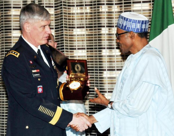 PIC.6.PRESIDENT MUHAMMADU BUHARI (R) RECEIVING A SOUVENIR FROM  THE VISITING COMMANDER OF THE  U.S. AFRICAN COMMAND, GEN. DAVID  RODRIGUEZ, IN ABUJA ON WEDNESDAY (14/10/15). 7140/14/10/2015/ICE/CH/NAN
