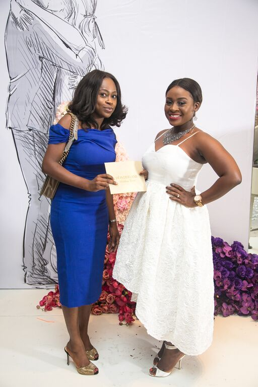 Yeside Laguda of Blush by MyQ presenting the Wedding Dress prize to Blessing
