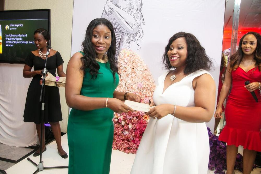 Ufuoma Udjoh presenting the Baileys Cocktail Bar to the #BBNWonderland Bride winner