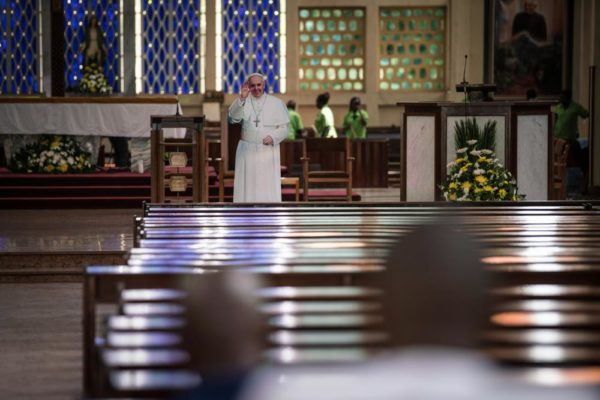 NAIROBI, KENYA - NOVEMBER 24: Worshipers pray at the Holy Family Basilica where an effigy representing Pope Francis has been set up on the altar on November 24, 2015 in Nairobi, Kenya. Pope Francis makes his first visit to Kenya on a five day African tour that is scheduled to include Uganda and the Central African Republic. Africa is recognised as being crucial to the future of the Catholic Church with the continentís Catholic numbers growing faster than anywhere else in the world. (Photo by Nichole Sobecki/Getty Images)