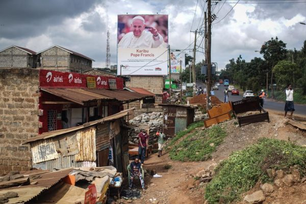 NAIROBI, KENYA - NOVEMBER 24: A poster welcoming Pope Francis to Kenya is pictured in the Kangemi slum on November 24, 2015 in Nairobi, Kenya. Pope Francis makes his first visit to Kenya on a five day African tour that is scheduled to include Uganda and the Central African Republic. Africa is recognised as being crucial to the future of the Catholic Church with the continent's Catholic numbers growing faster than anywhere else in the world. (Photo by Nichole Sobecki/Getty Images)