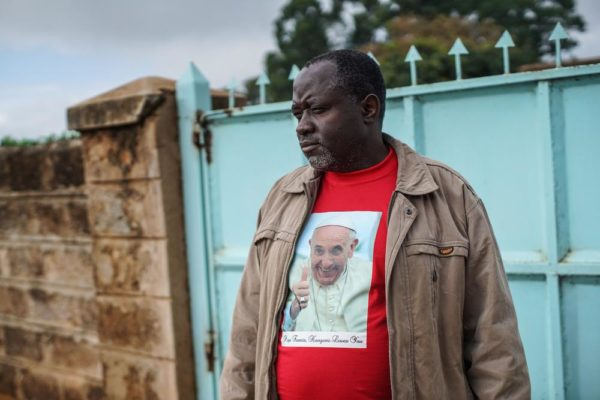NAIROBI, KENYA - NOVEMBER 24: Father Paschal Mwijage of the St. Joseph the Worker Parish in Nairobi's Kangemi slum wears a t-shirt of Pope Francis on November 24, 2015 in Kenya. Pope Francis makes his first visit to Kenya on a five day African tour that is scheduled to include Uganda and the Central African Republic. Africa is recognised as being crucial to the future of the Catholic Church with the continent's Catholic numbers growing faster than anywhere else in the world. (Photo by Nichole Sobecki/Getty Images)