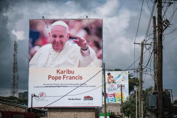 NAIROBI, KENYA - NOVEMBER 24: A poster welcoming Pope Francis to Kenya is pictured in the Kangemi slum on November 24, 2015 in Nairobi, Kenya. Pope Francis makes his first visit to Kenya on a five day African tour that is scheduled to include Uganda and the Central African Republic. Africa is recognised as being crucial to the future of the Catholic Church with the continentís Catholic numbers growing faster than anywhere else in the world. (Photo by Nichole Sobecki/Getty Images)