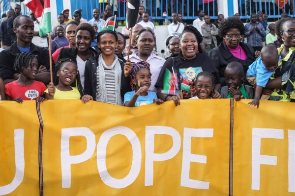 NAIROBI, KENYA - NOVEMBER 25: Crowds of people gather on the roadside as Pope Francis' convoy drives through the capital from the airport on November 25, 2015 in Nairobi, Kenya. Pope Francis makes his first visit to Kenya on a five day African tour that is scheduled to include Uganda and the Central African Republic. Africa is recognised as being crucial to the future of the Catholic Church with the continent's Catholic numbers growing faster than anywhere else in the world. (Photo by Nichole Sobecki/Getty Images)