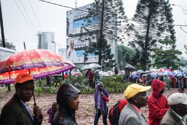 NAIROBI, KENYA - NOVEMBER 26: Crowds gather at the University of Nairobi grounds despite the rain on November 26, 2015, to attend a mass delivered by Pope Francis in Nairobi, Kenya. Pope Francis makes his first visit to Kenya on a five day African tour that is scheduled to include Uganda and the Central African Republic. Africa is recognised as being crucial to the future of the Catholic Church with the continent's Catholic numbers growing faster than anywhere else in the world. (Photo by Nichole Sobecki/Getty Images)