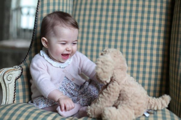 ANMER HALL, ENGLAND - UNDATED:  In this undated handout photo provided by HRH The Duchess of Cambridge, Princess Charlotte of Cambridge plays with a teddy as she is seen at Anmer Hall earlier this month taken by Catherine, Duchess of Cambridge in Sandringham, England. (Photo by HRH The Duchess of Cambridge via Getty Images) EDITORIAL USE ONLY. NO COMMERCIAL USE (including any use in merchandising, advertising or any other non-editorial use including, for example, calendars, books and supplements). This photograph is provided to you strictly on condition that you will make no charge for the supply, release or publication of it and that these conditions and restrictions will apply (and that you will pass these on) to any organisation to whom you supply it. All other requests for use should be directed to the Press Office at Kensington Palace in writing.