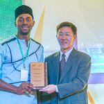 Most Oustanding Fellow Awardee Saeed Jumah with Qin Jian of the Embassy of the People's Republic of China