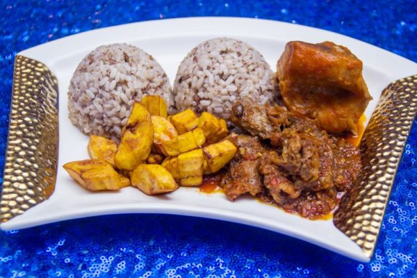 Ofada Rice Fried Plantain Assorted Meats Ayamashe Sauce and Stewed Fish