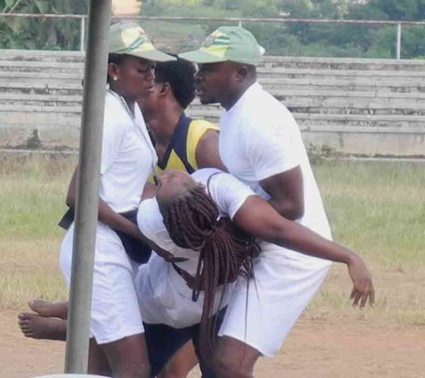 PIC. 14. CORPS MEMBERS EVACUATING THEIR A FEMALE COLLEAGUE THAT COLLAPSED DURING THE EARLY MORNING DRILL, AT  NYSC PERMANENT ORIENTATION CAMP, GBAKUTA VILLAGE, ON ISEYIN-OKEHO ROAD, IN OYO STATE ON MONDAY (9/11/15). 7074/9/11/2015/IBRO/BJO/NAN