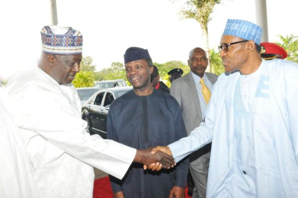 PIC.2.SECRETARY TO THE GOVERNMENT OF THE FEDERATION, MR DAVID LAWAL (L) WELCOMING PRESIDENT MUHAMMADU BUHARI TO THE PRESIDENTIAL RETREAT FOR MINISTERIAL-DESIGNATES AT THE PRESIDENTIAL VILLA IN ABUJA ON THURSDAY (05/11/15). WITH THEM IS THE VICE PRESIDENT YEMI OSINBAJO. 7007/05/11/2015/ICE/CH/NAN
